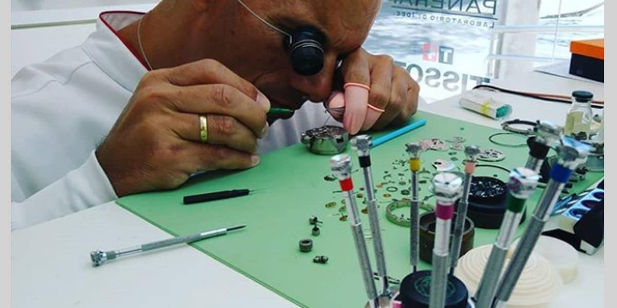 Watchmaker inspecting a watch for a service
